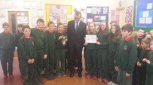 Sixth class receiving their MATHletes school challenge cup from John Paul Phelan